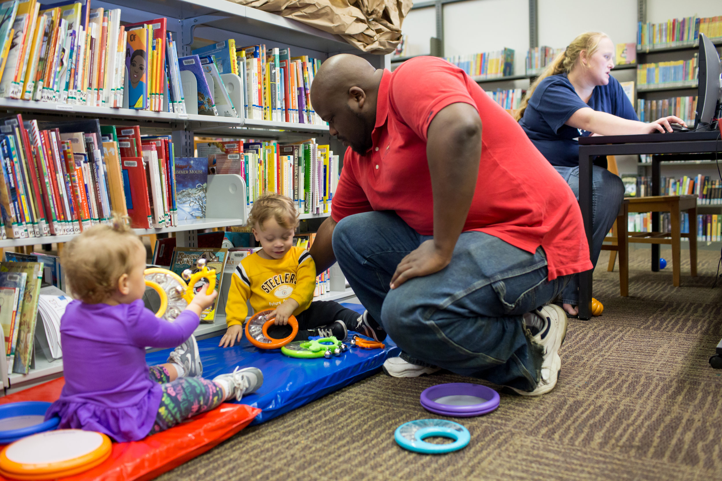 Caregivers and children play and explore at CLP – Sheraden's Family PlayShop