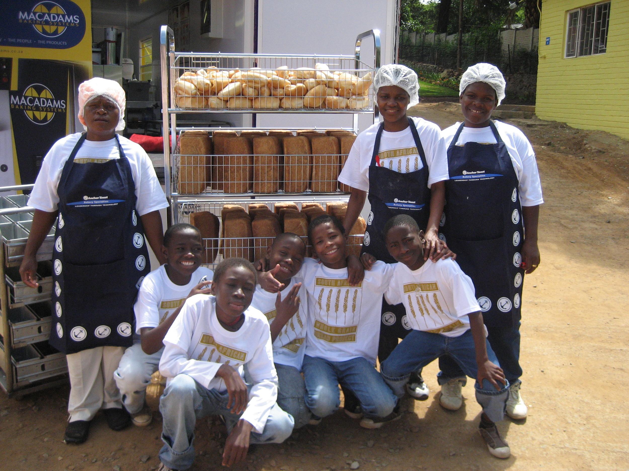 Nkosi bakers and kids.JPG