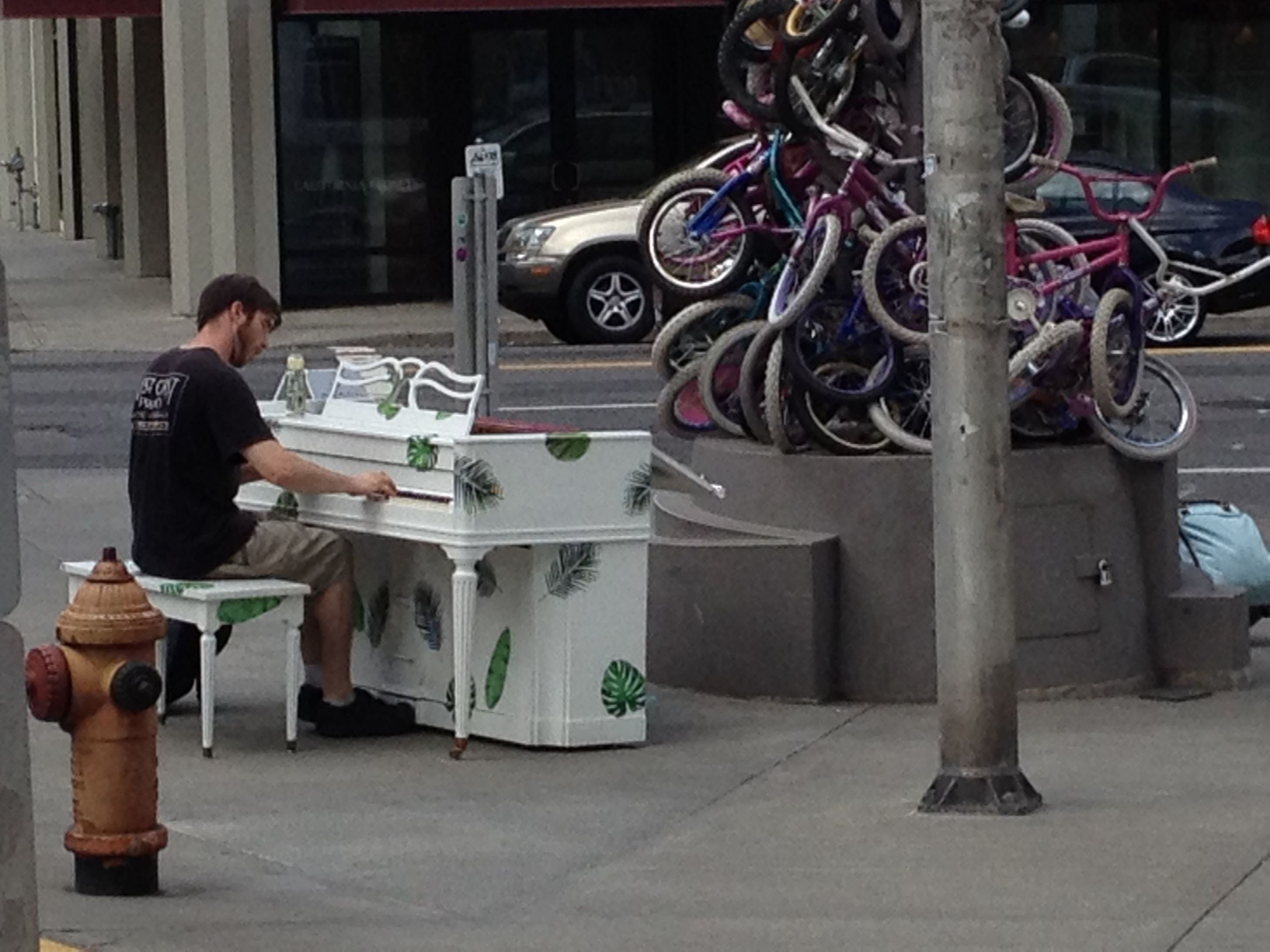 Respite between shows...in Portland, Oregon there are random pianos scattered around town for anyone to play. This spot happened to also have a tiers bicycle totem.
