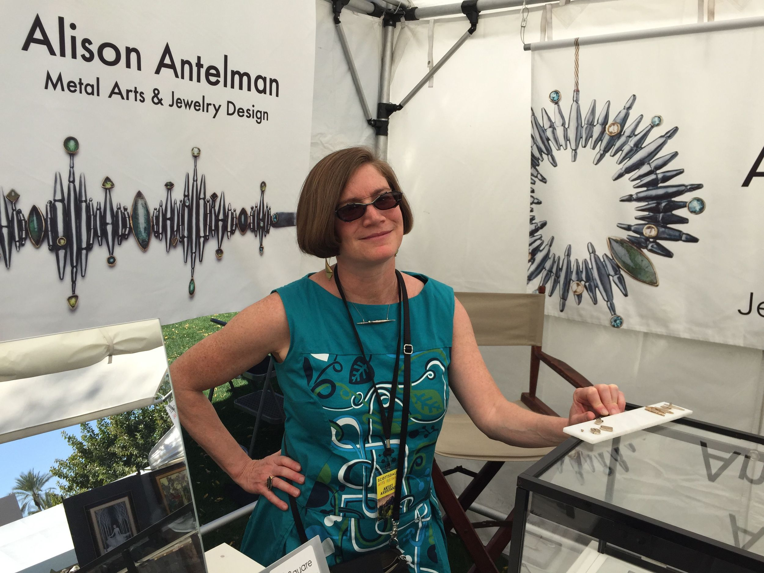 In my booth at the Scottsdale Arts Festival..with jewelry banners larger than life.