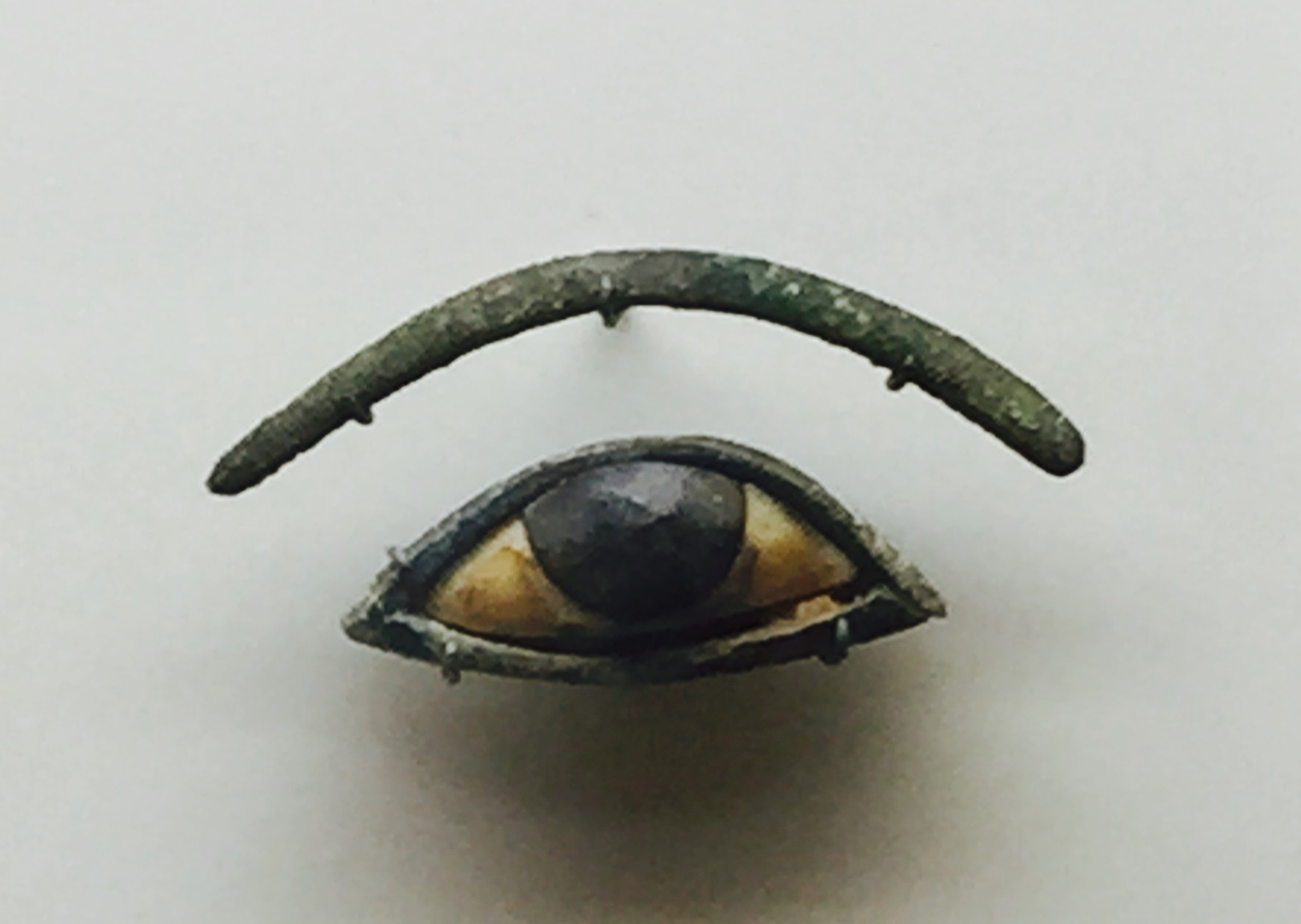 Eye and Eyebrow inlays. 1293 to 715 BCE. Ivory, Obsidian and the eyebrow is bronze.