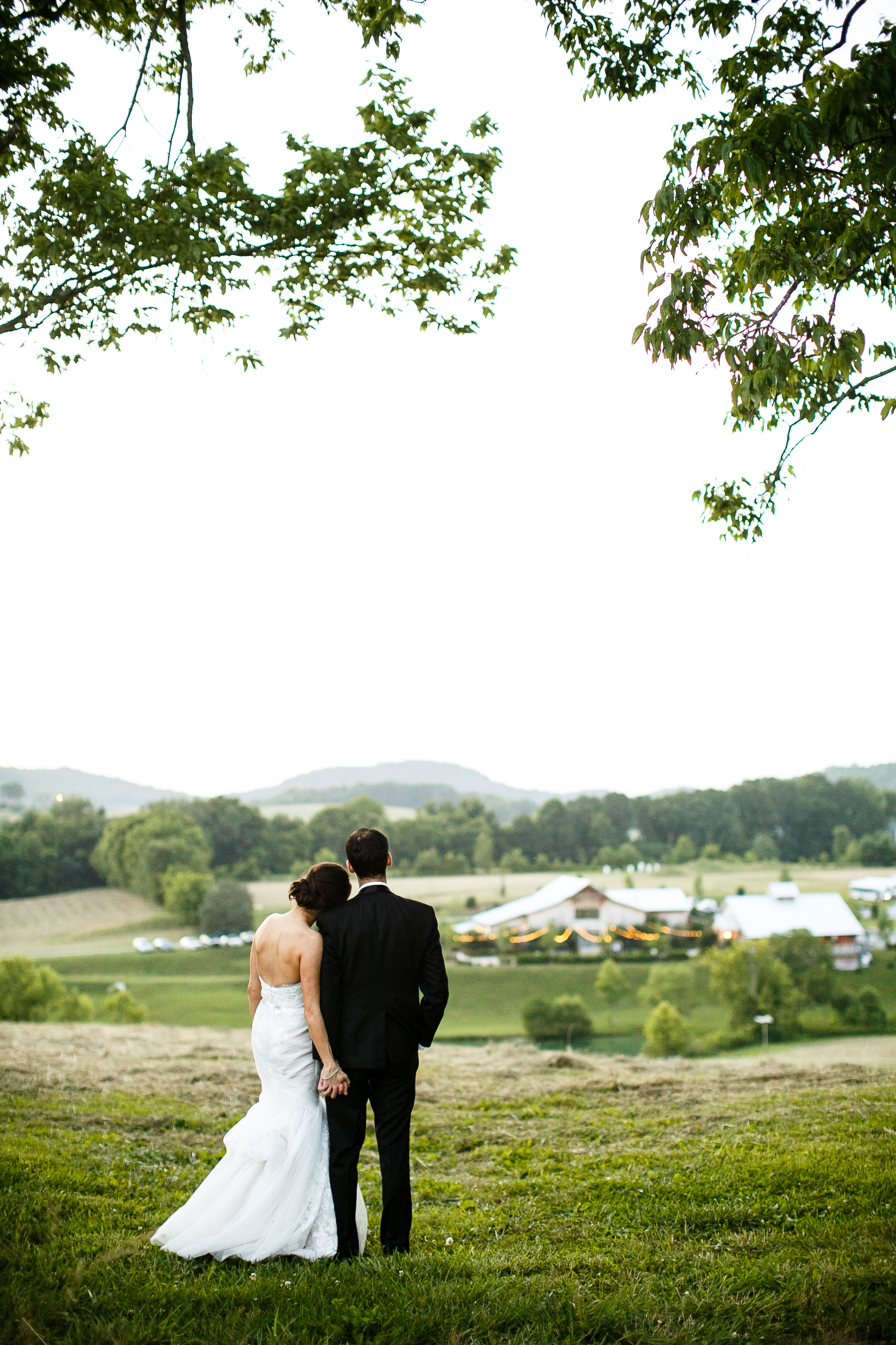 Bride and Groom with scenery and greenery by JanelleElisePhotography.jpg