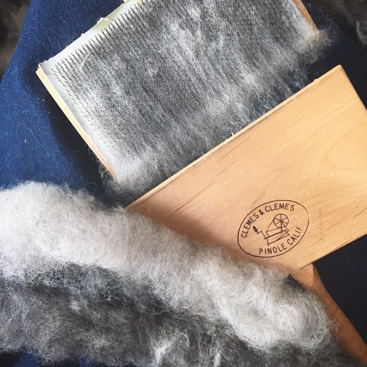 Hand carding some Jacobs Fleece