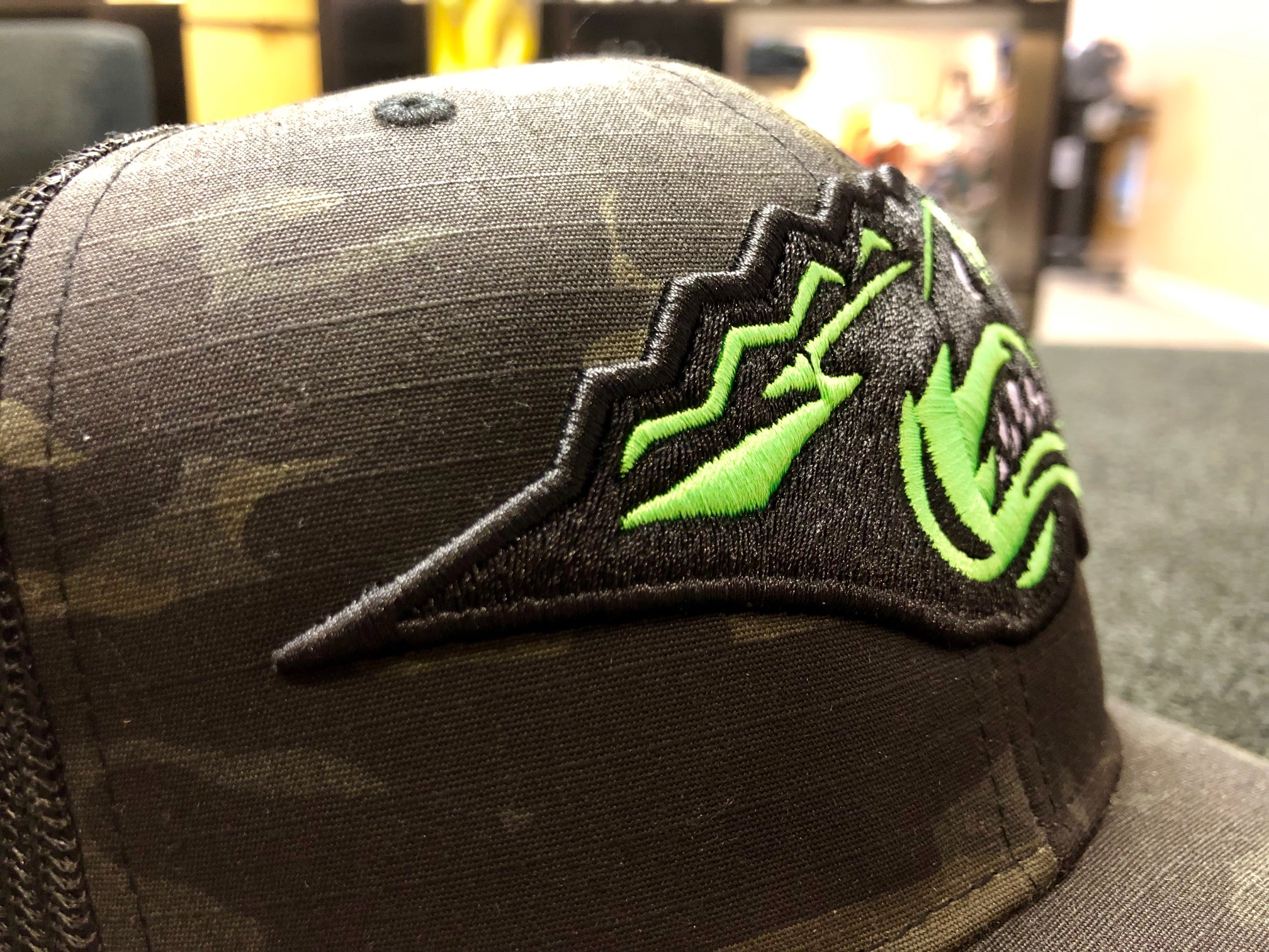 logounltd_laser_etching_embroidery_screen_printing_apparel_uniform_custom_tshirts_kirkland_bellevue_seattle_redmond_woodinville_branded_merchandise_promotional_products_logo_unltd_green_river_college_hat (5).jpg