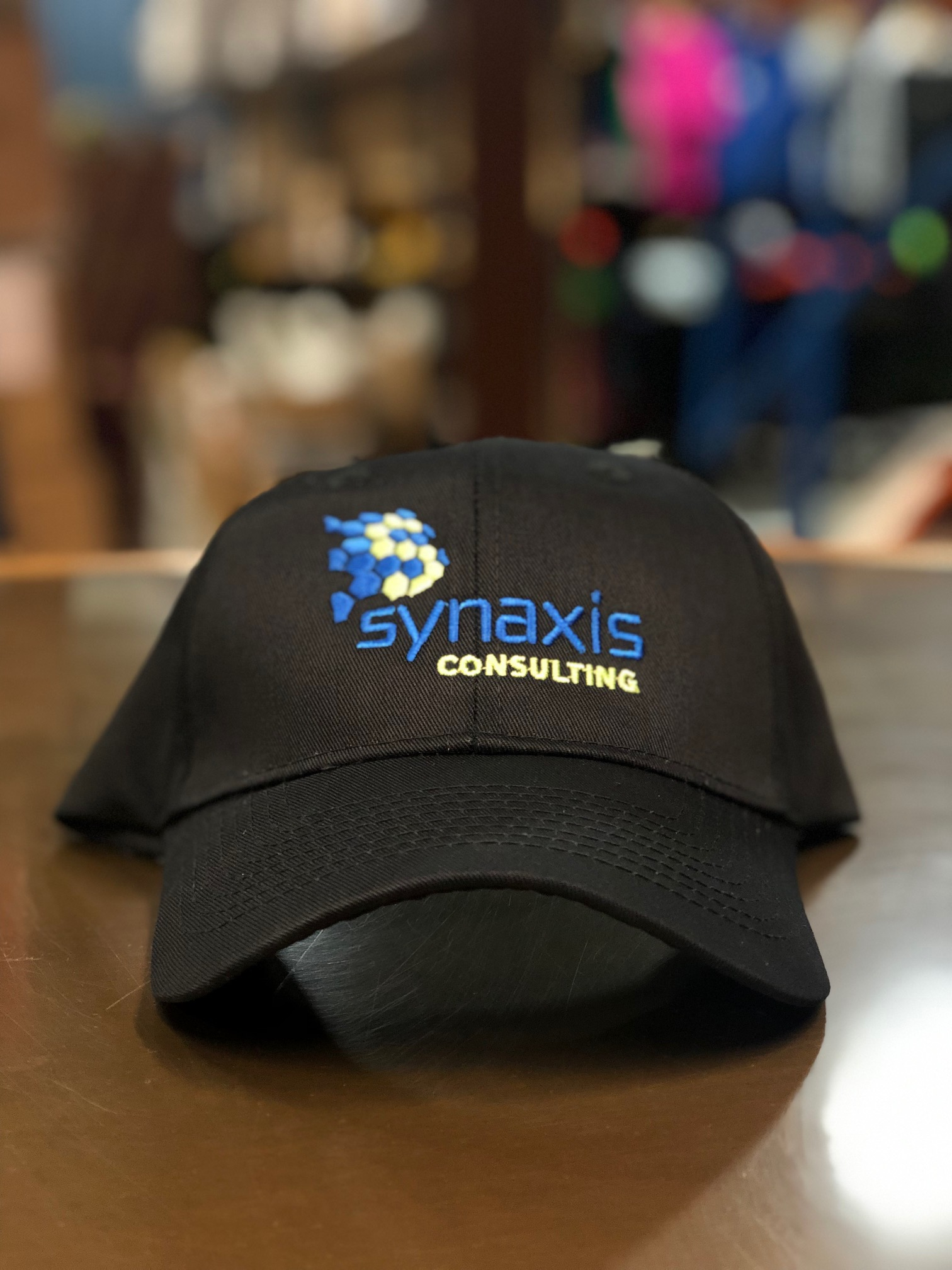 logounltd_laser_etching_embroidery_screen_printing_apparel_uniform_custom_tshirts_kirkland_bellevue_seattle_redmond_woodinville_branded_merchandise_promotional_products_logo_unltd_hat_synaxes.jpg