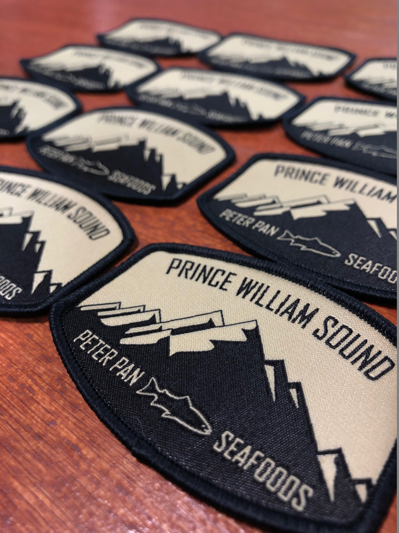 logounltd_laser_etching_embroidery_screen_printing_apparel_uniform_custom_tshirts_kirkland_bellevue_seattle_redmond_woodinville_branded_merchandise_promotional_products_logo_unltd_woven_patches_peter_pan_seafoods (1).jpg