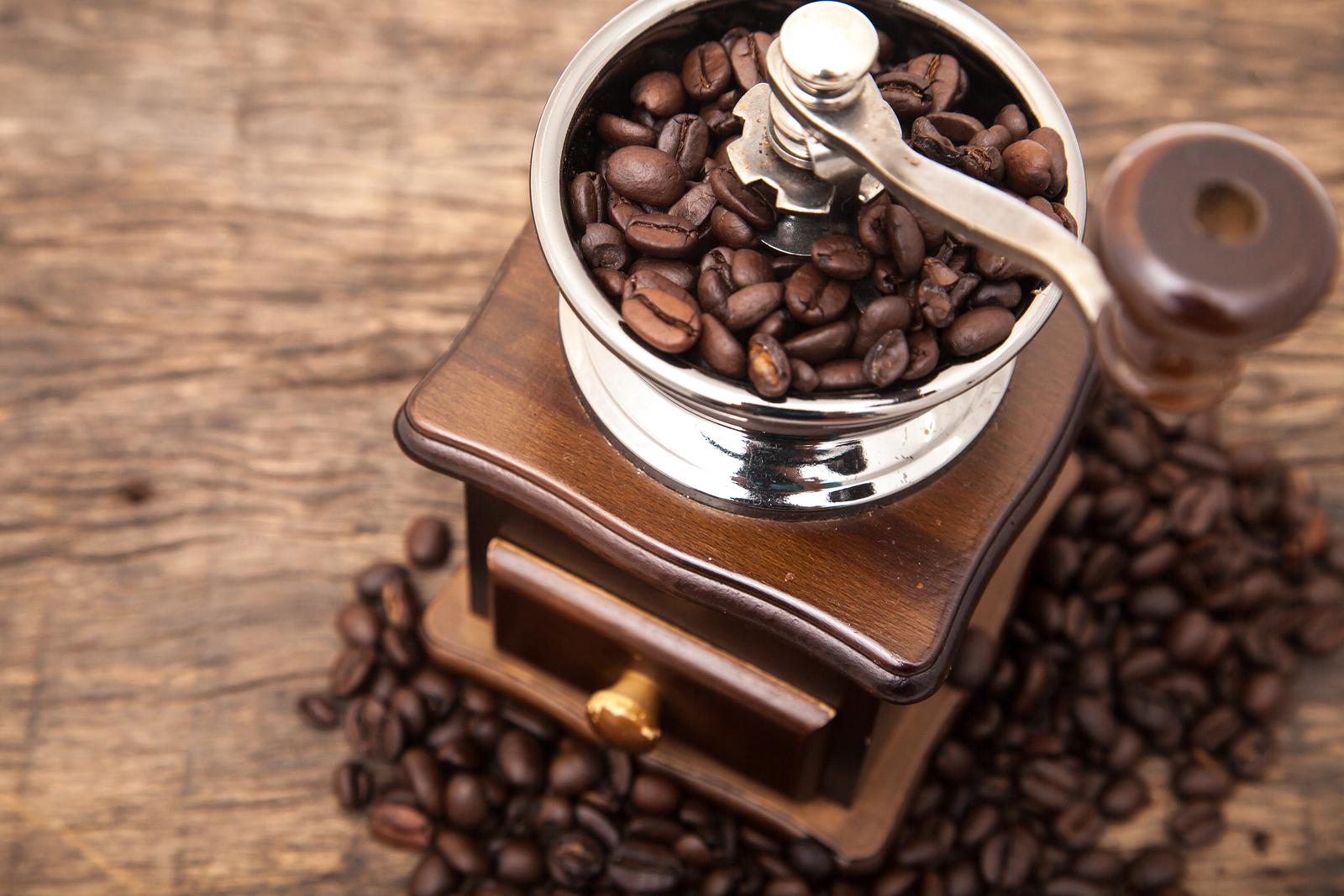 bigstock-Close-Up-Fresh-Coffee-Bean-In--67713217.jpg