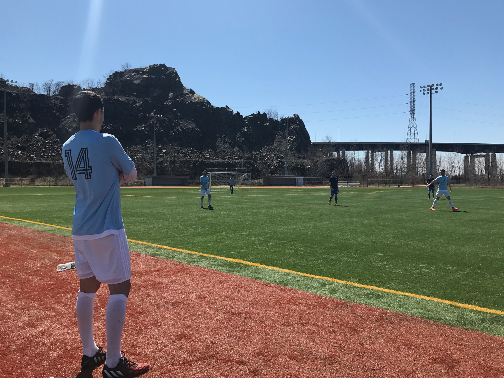 Bryan Baracaldo watches on as the Manhattan Kickers first team looks to find the first goal of the game.
