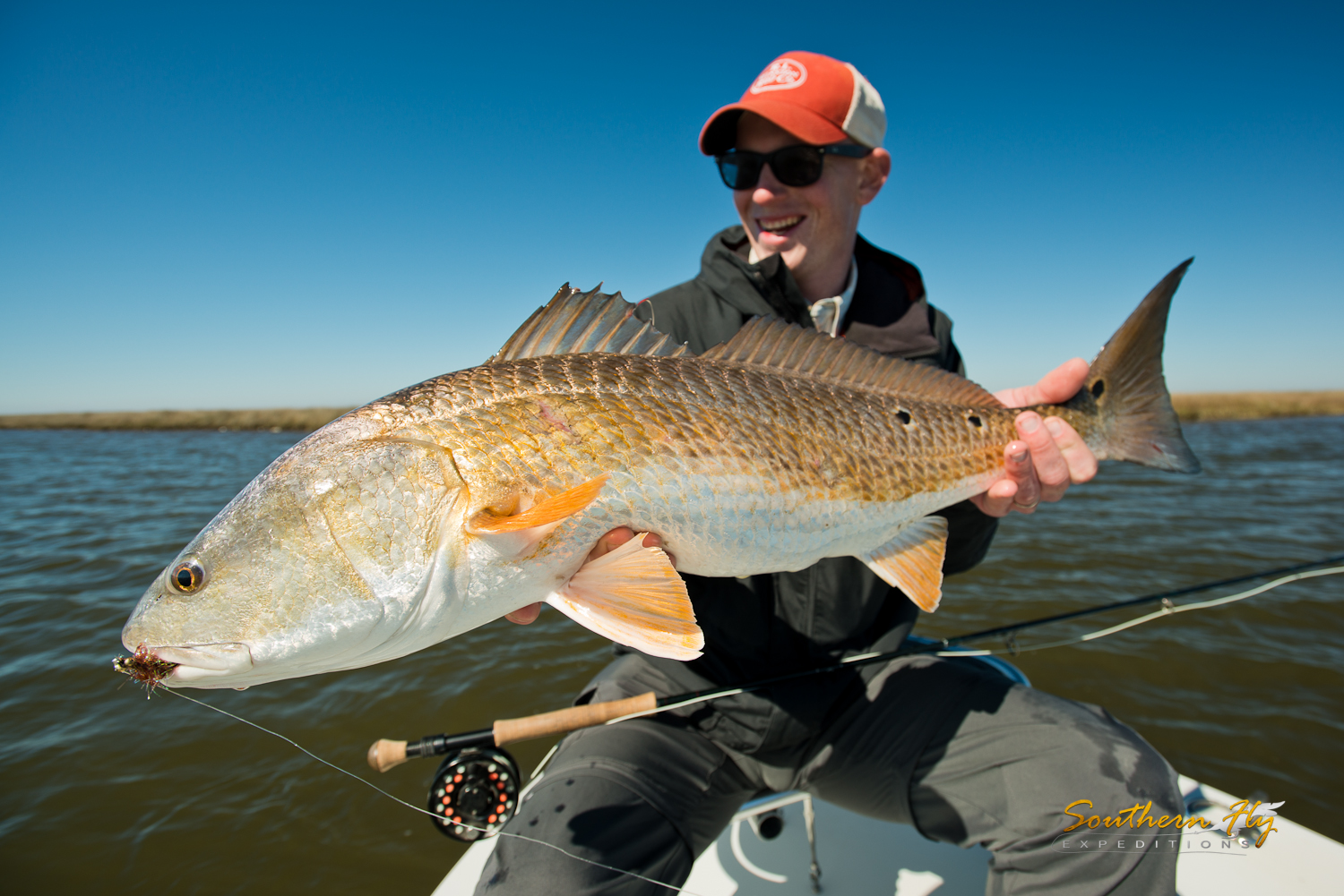 Fly fishing for huge redfish louisiana with southern fly expeditions and captain brandon keck