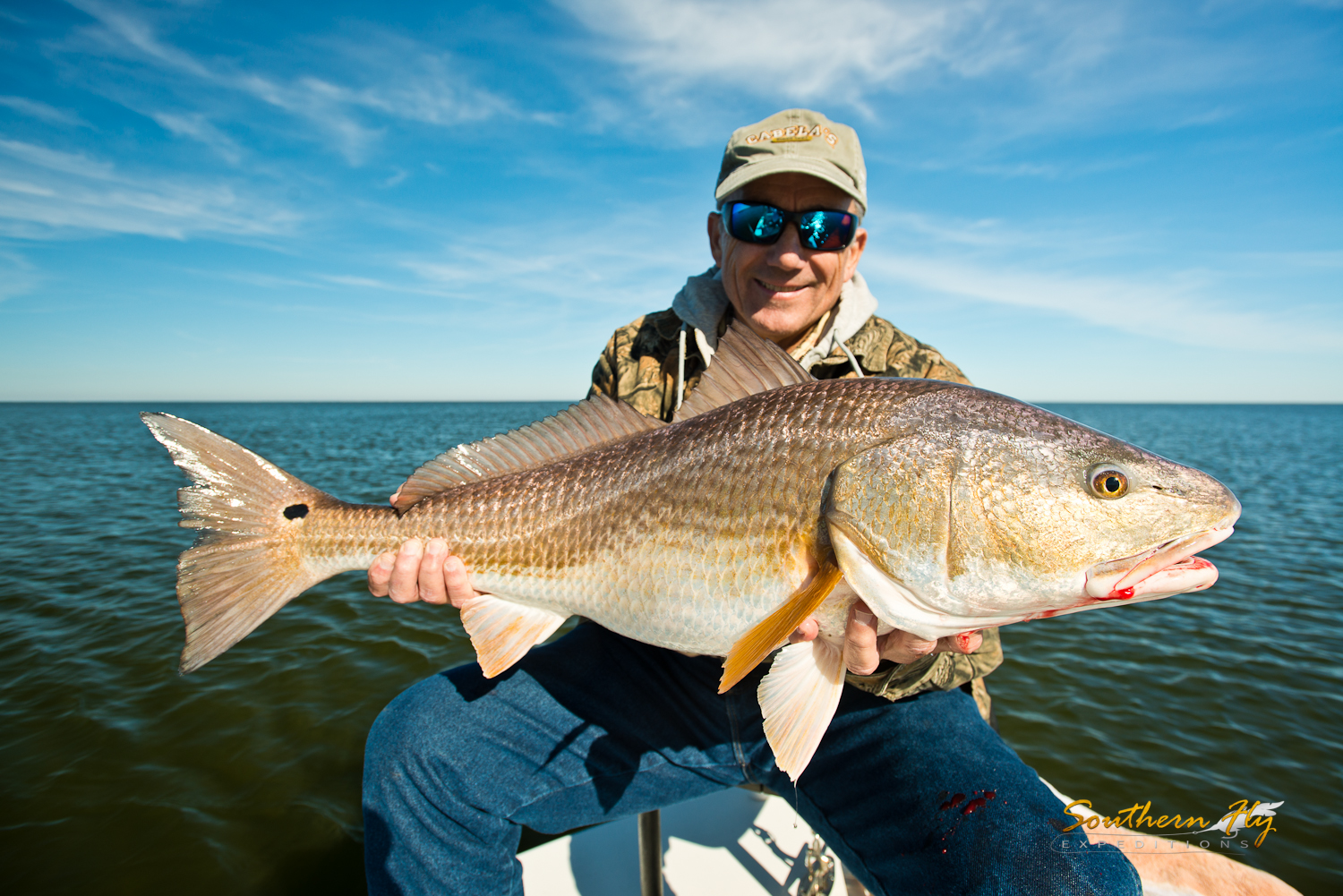 Spin Fishing Bull Reds with Fly Fishing Charter Southern Fly Expeditions