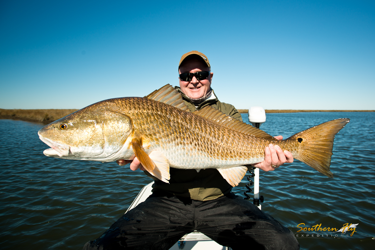 fly fishing for huge redfish with southern fly expeditions