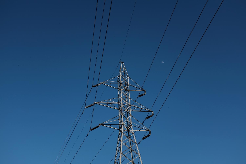 Power lines containing a small moon. Hidden Falls Park.