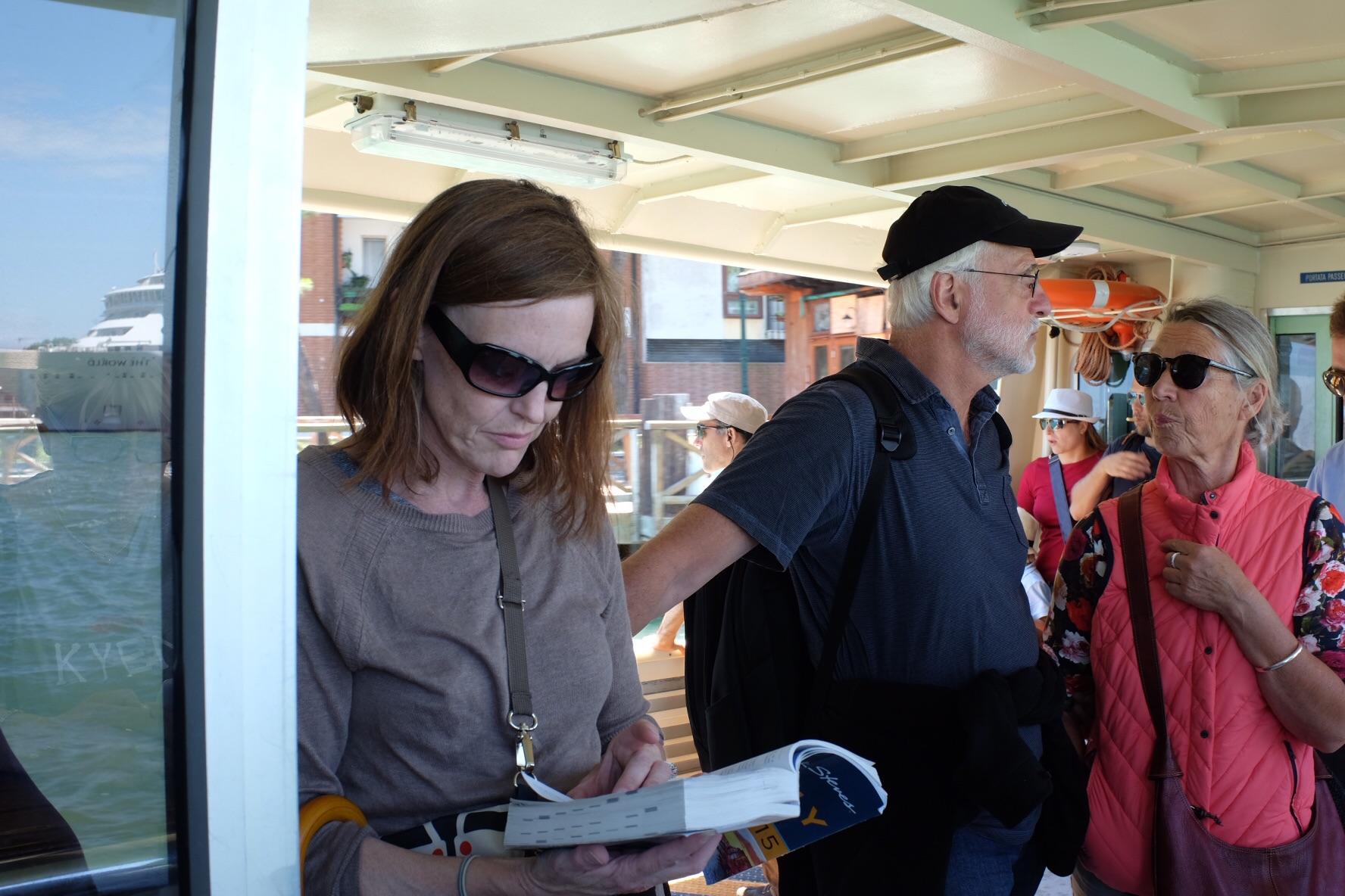 Tourist reading on vaporetto