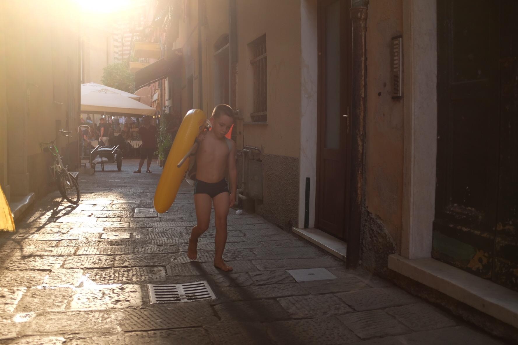 Kid running with innertube