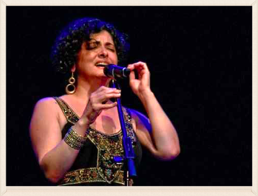 "Vocalist Gaida (shown here) is known for her original and highly personal style marked by great emotional intensity. The ""Syrian Nightingale"" ""evokes the emotional storminess of legendary singers like Warda and Om Kalthoum"