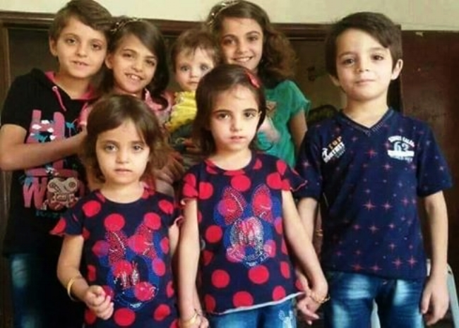 Photo of the children of the Sayeh family: Hamza, Rand, Bebars, Remas, Weam, Assil, Leen Sayeh