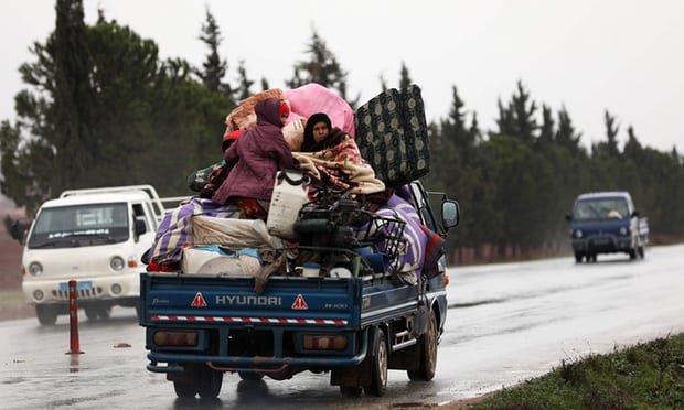 Displaced people from a village in southern Idlib head on the Damascus-Aleppo motorway towards the northern part of the rebel-held province. Photograph: Omar Haj Kadour/AFP/Getty Images