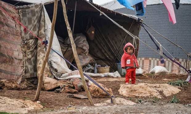 A displaced child at the Atamah camp on the Syrian-Turkish border. Over 20,000 families are now living here. Photograph: Yahya Nemah/EPA