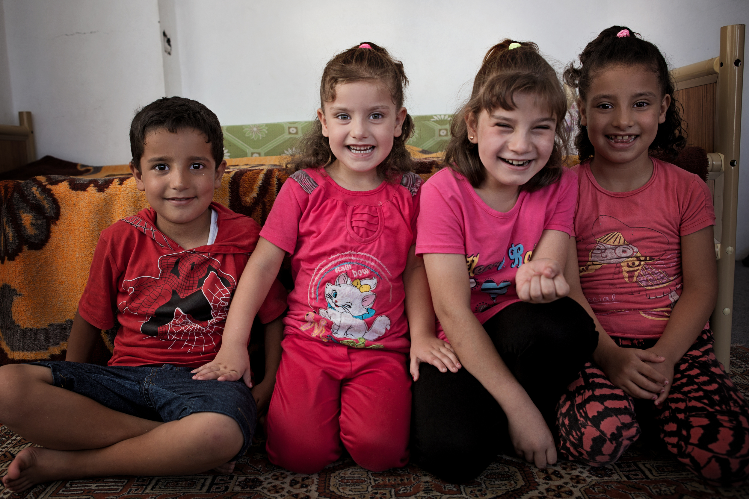 Mahmoud, Duaa, Aisha, & Esraa   Our family is originally from Homs, Syria. We fled to Reyhanli in 2014. We lived with our mother, grandmother, uncle, and his wife and kids in one small apartment. We have not heard from our father since he was arrested in Syria in 2012. Before joining Karam's SSRF program in 2015, none of us were in school, we had missed 2 years of schooling due to the war. Today, Aisha, Mahmoud, Duaa, Aisha, and Esraa are all enrolled in school. We are learning Turkish. Aisha has dreams of being a doctor one day.