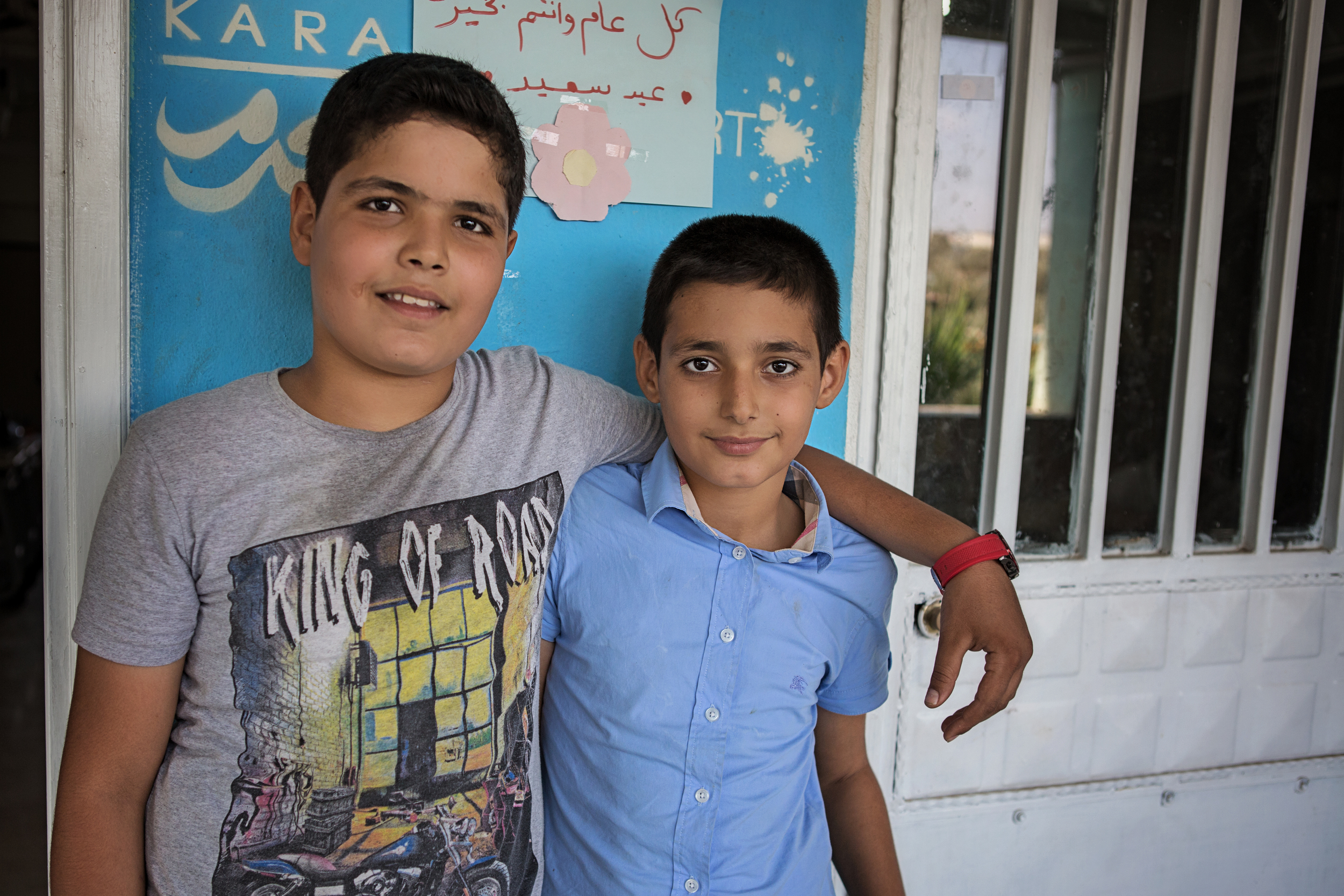 Ibrahim and Nadim   Before meeting Karam Foundation in 2015, we were both working 12-hour shifts 6 days a week. Nadim was working in glassblower's shop and Ibrahim worked at a sweets shop. After joining Karam's SSRF program we were able to quit our jobs and go back to school. Since starting school, our behavior has really improved. We've joined Karam House and we study hard – we have very good grades.