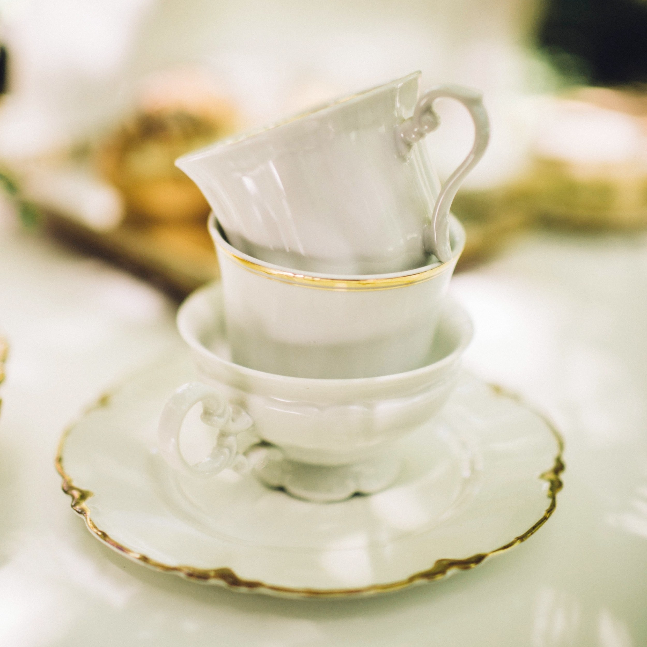 White + Gold Teacups and Saucers