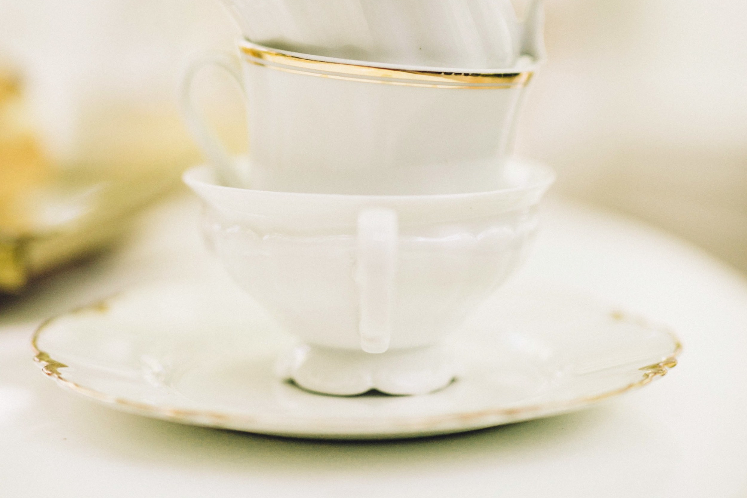 White + Gold Teacup and Saucer