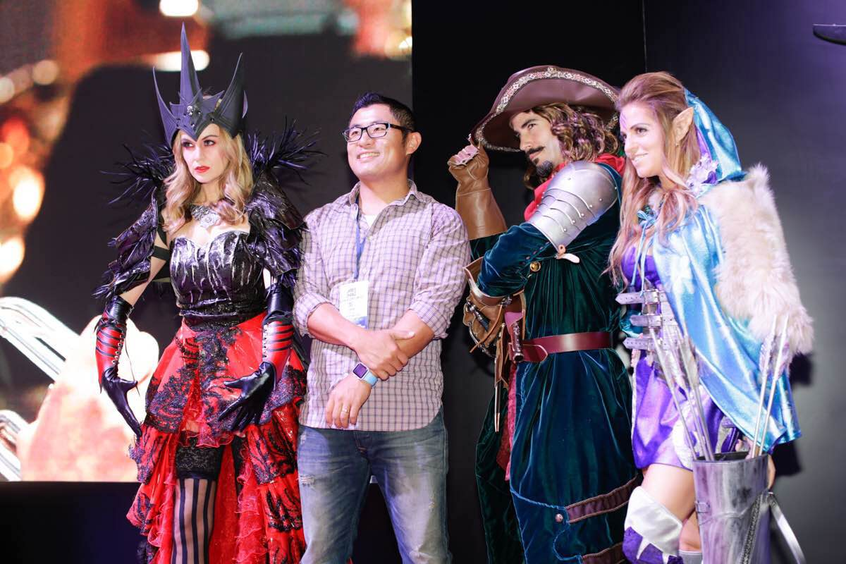 Concept Art House CEO, James Zhang, at the  Relics of Gods  booth.