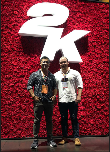 James and Davis representing CAH in front of 2K's impressive wall of roses