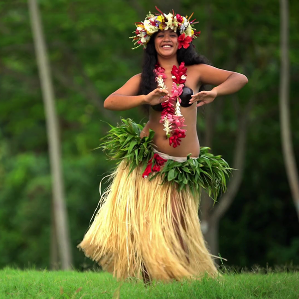 polynesian-graceful-girl-dancer-in-grass-skirt-and-flower-headdress-dancing-hula-style-while-entertaining-barefoot-outdoors-tahiti-french-polynesia_hit3dkl7g_thumbnail-full01.png