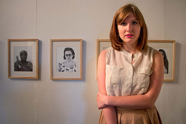 Taylor in front of her exhibition  Guarded  at PS1 in 2015