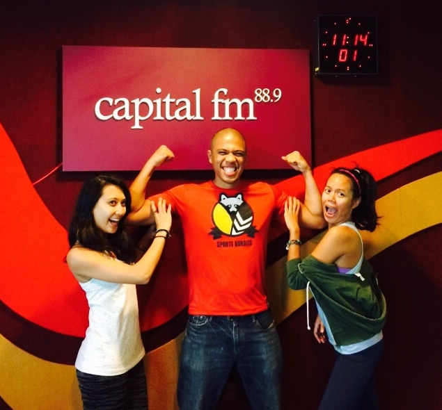 CEO of Sports Bandits, Rezhan Majod (centre), with radio announcers Isabel and Edea from Capital FM (88.9) after the recording of his interview with the station