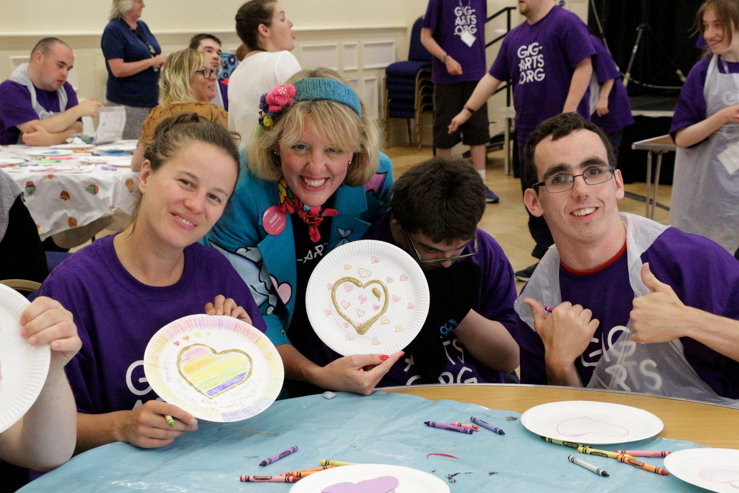 Grace and Abbie work with the teams to create love heart artworks to give to the community.
