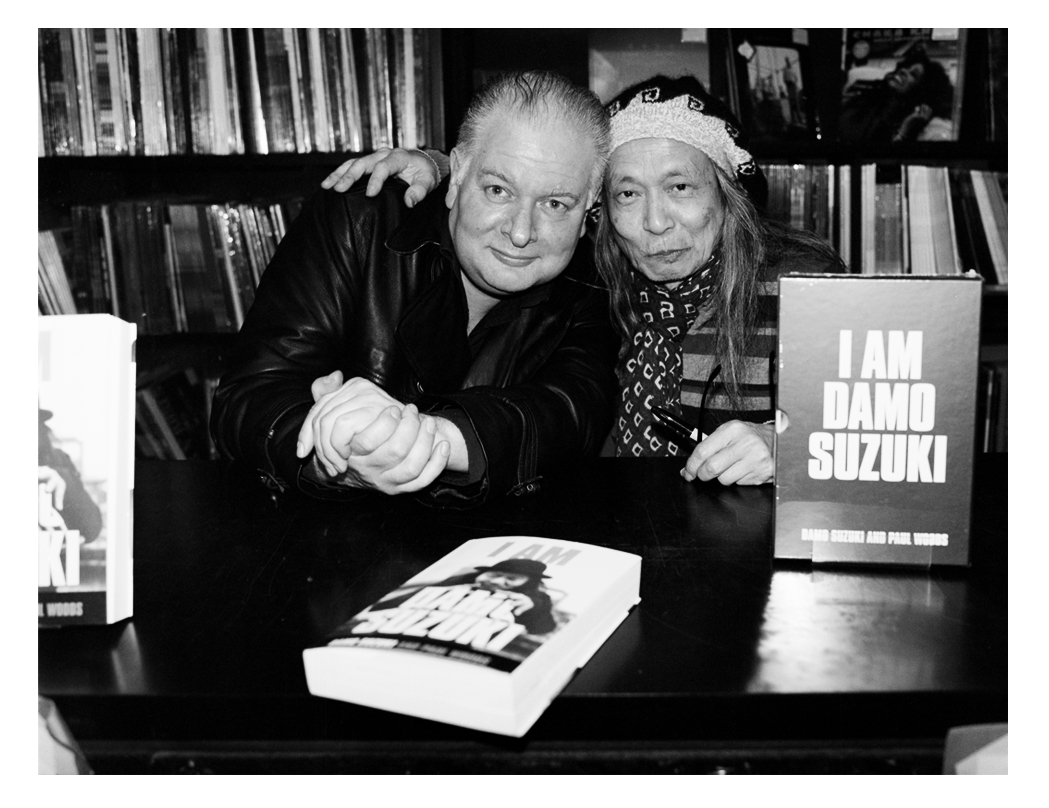 The write Paul Woods with Damo-book signing and launch for the Omnibus release 'I Am Damo Suzuki' Rough Trade Records 2019
