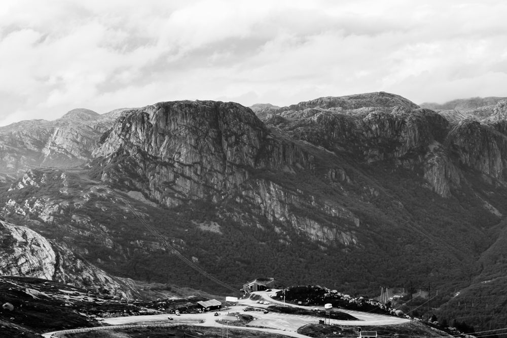 The tourist centre at the base of Kjerag faces granite outcrops across the fjord