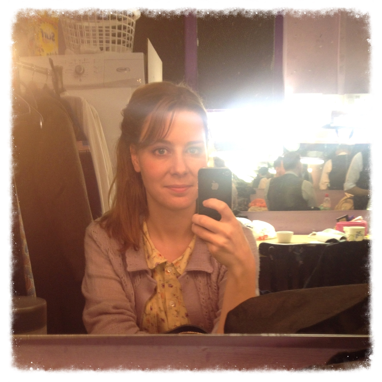 Backstage, moonlighting as an actress.