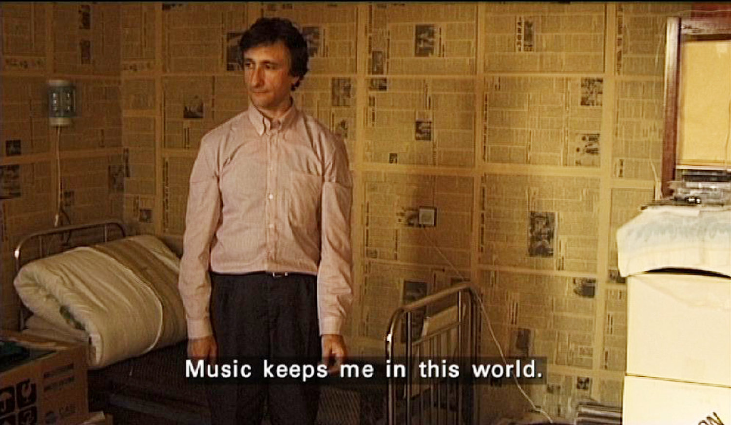 Vasily Zvarychuk at home with sub-title 'Music keeps me in this world'.