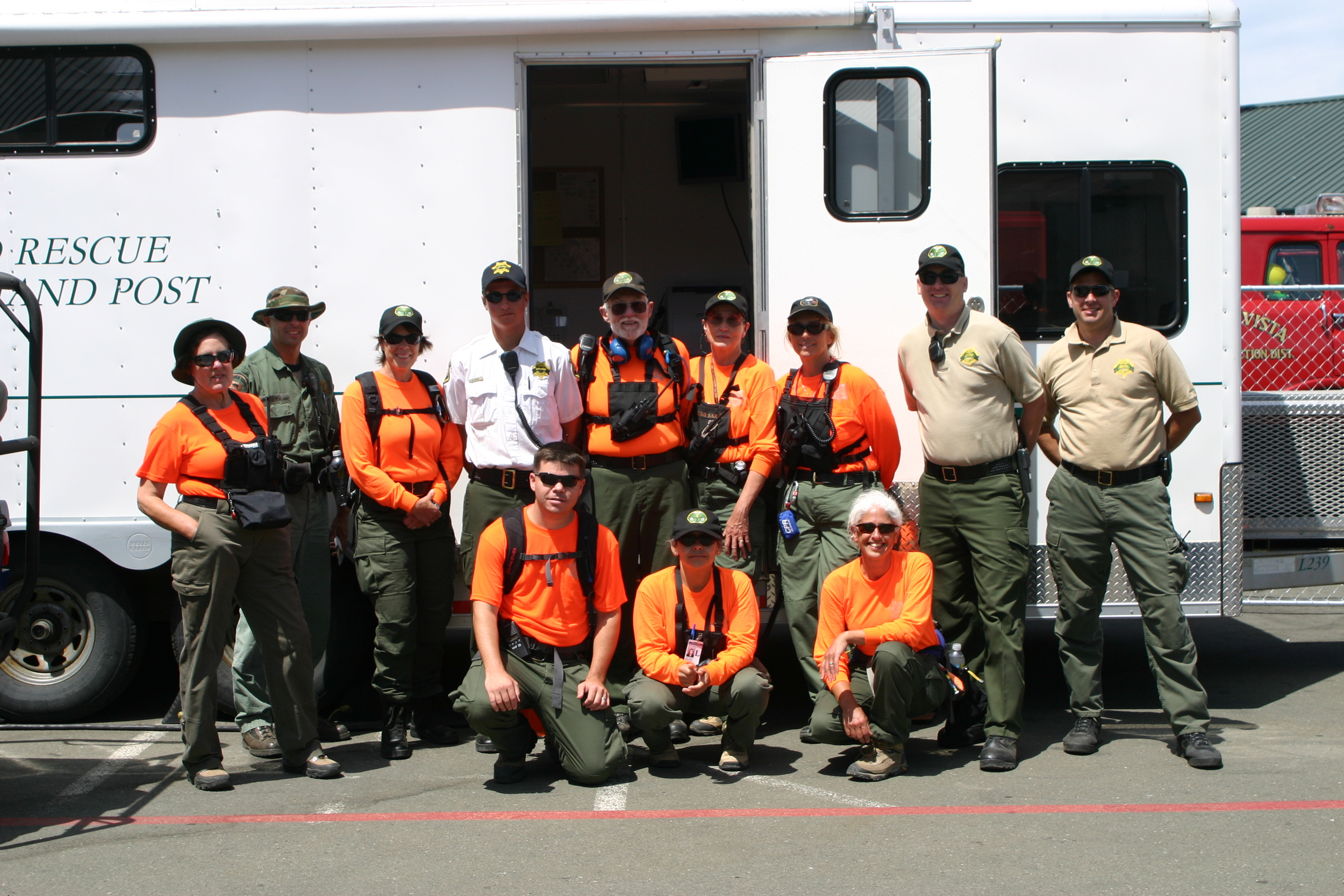 Search and Rescue team pauses for a photo opportunity at the SAR trailer.