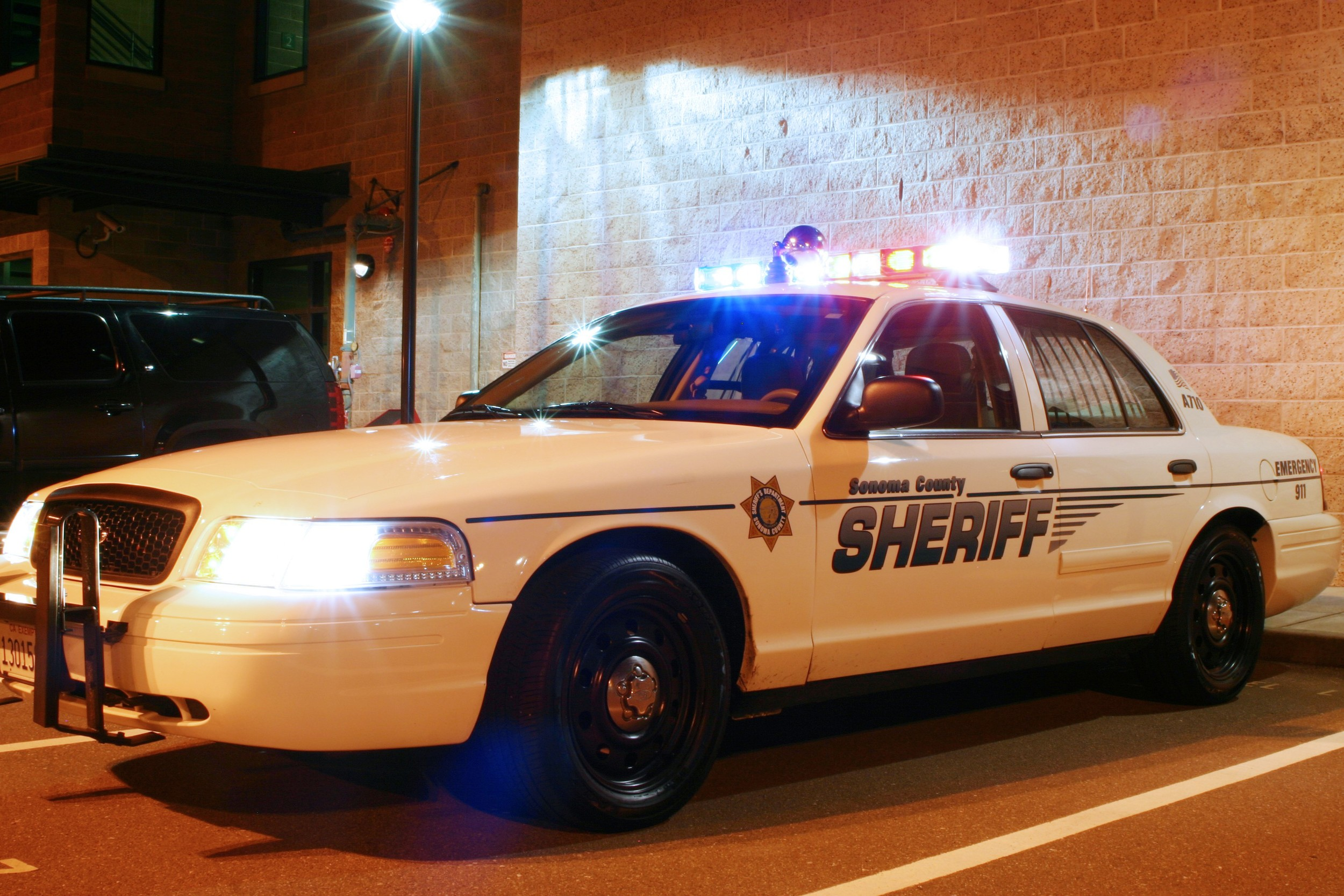 Ford Crown Victoria patrol vehicle at night.