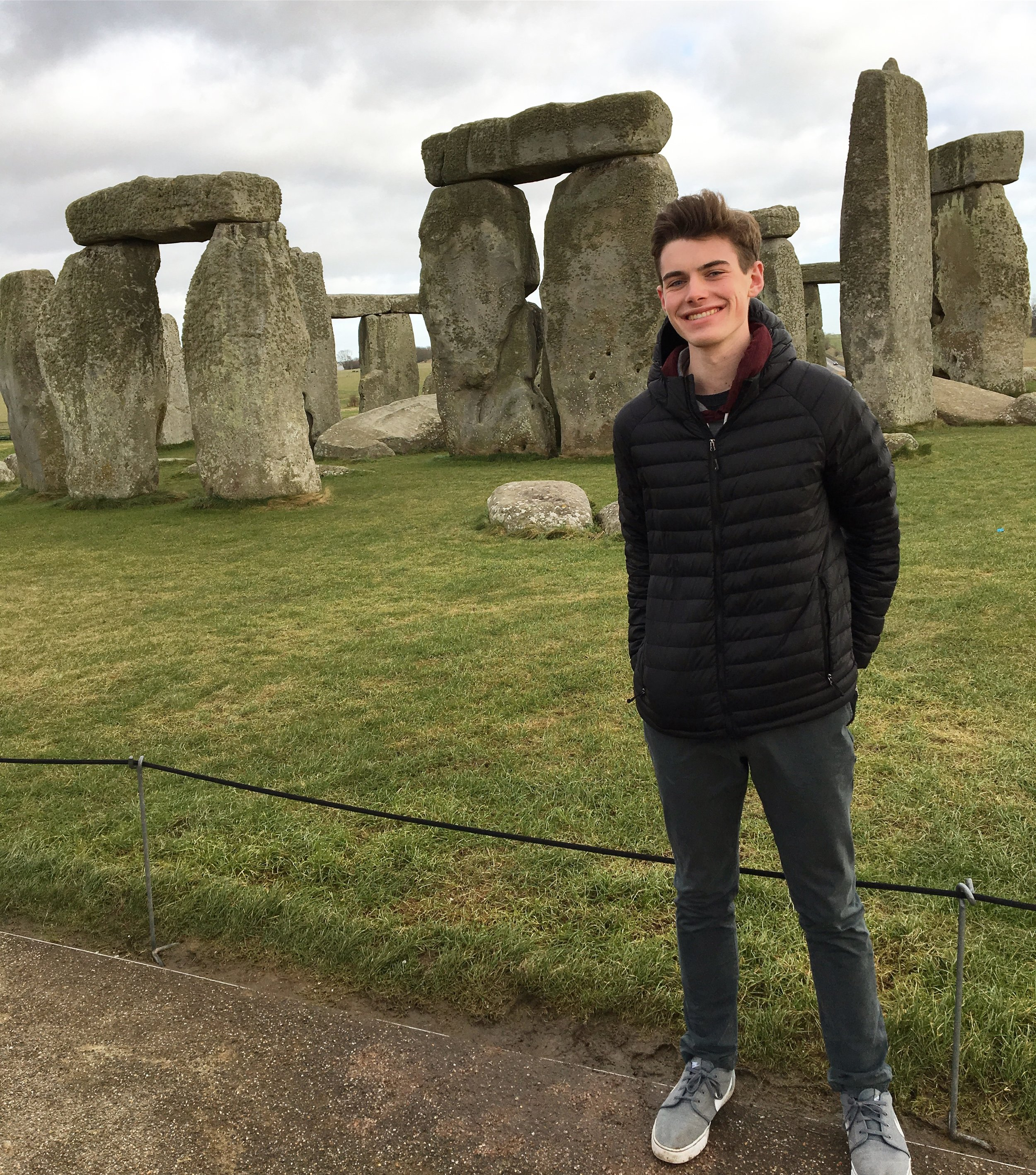 Brian Florenzo standing in front of Stonehenge on British Masters of Science Study Abroad Course.