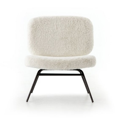 This faux angora chair combines the legs of a modernist piece with a far more welcoming seat.    Image source   .