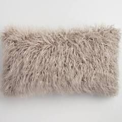 Never underestimate the power of a stylish, fuzzy pillow!    Image source   .
