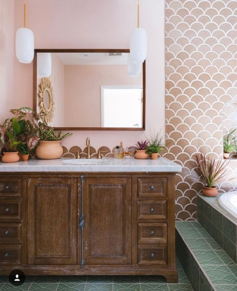 Love the touch of soft Moroccan glam these tiles add to the space. (   source   )