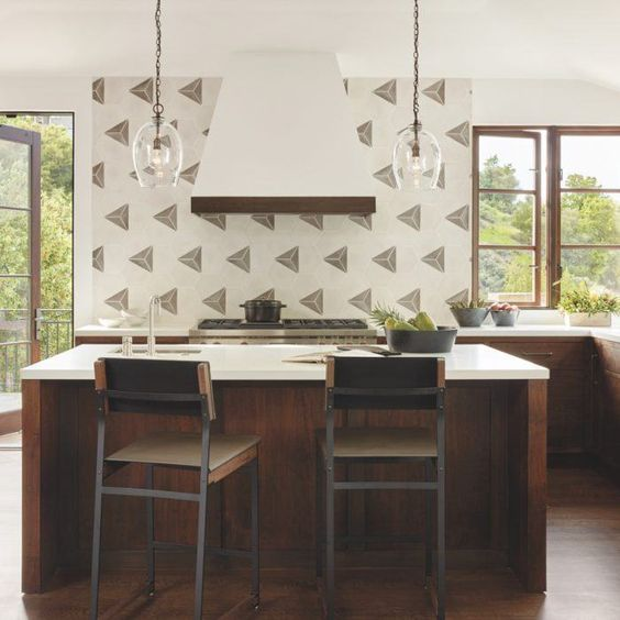 This clever backsplash    feels sophisticated yet playful. Can't get enough of it!