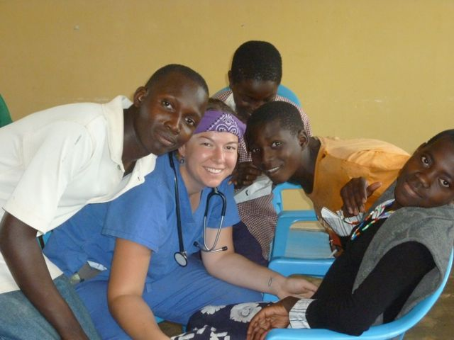 Kelly using her medical background to treat youth at a children's prison in Uganda