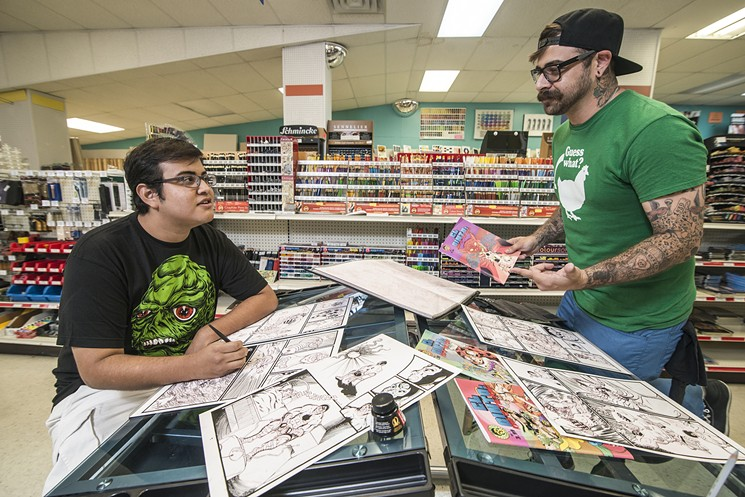 Jose Garcia (left) works on comics with Mike Wolfman.   Photo by: Can Turkyilmaz
