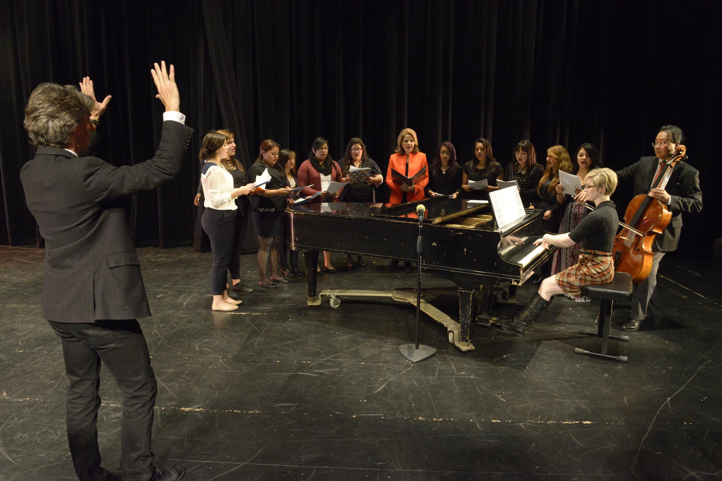Damian Woetzel, Ren é e Fleming and Yo-Yo Ma work with music students of Benito Juarez Community Academy