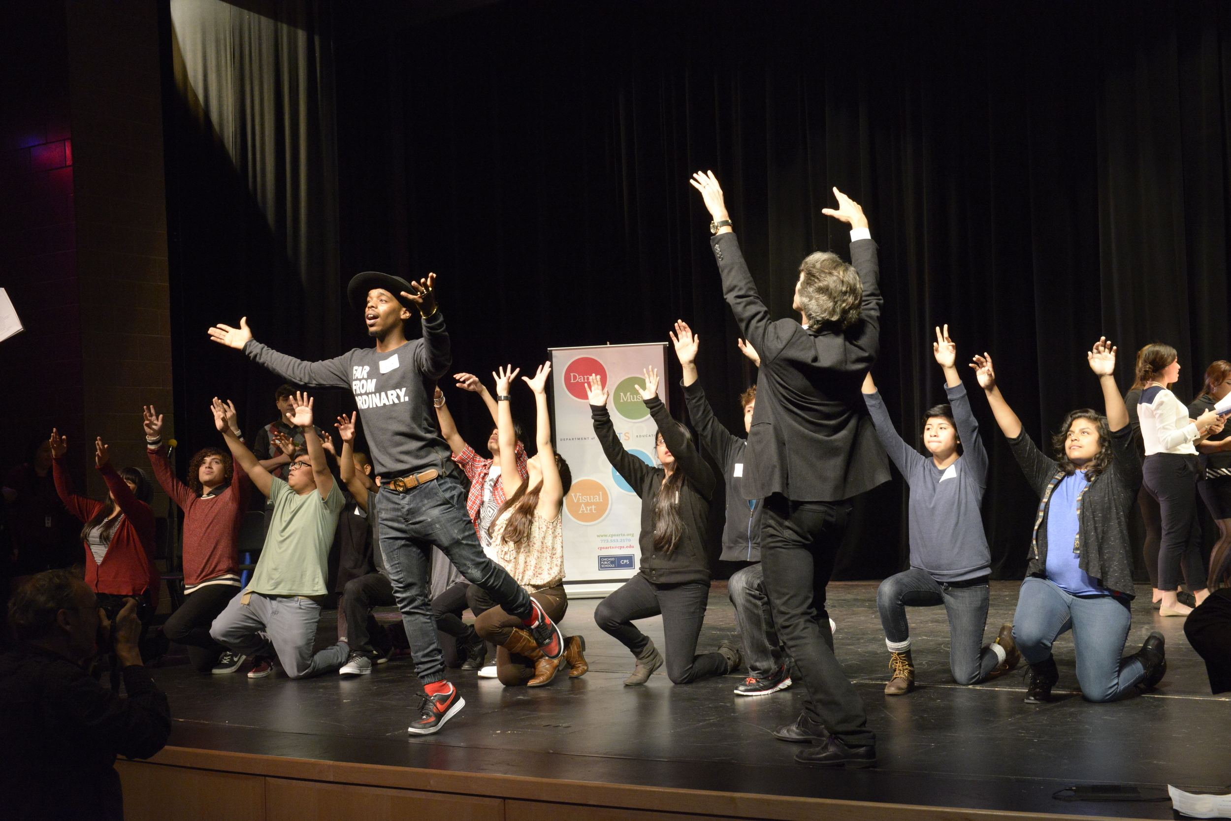 Drama students of Benito Juarez Community Academy are joined onstage by Damian Woetzel and Lil Buck
