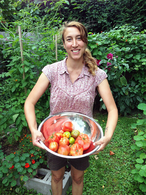 Anne Butera in Her Garden with a Harvest of Tomatoes