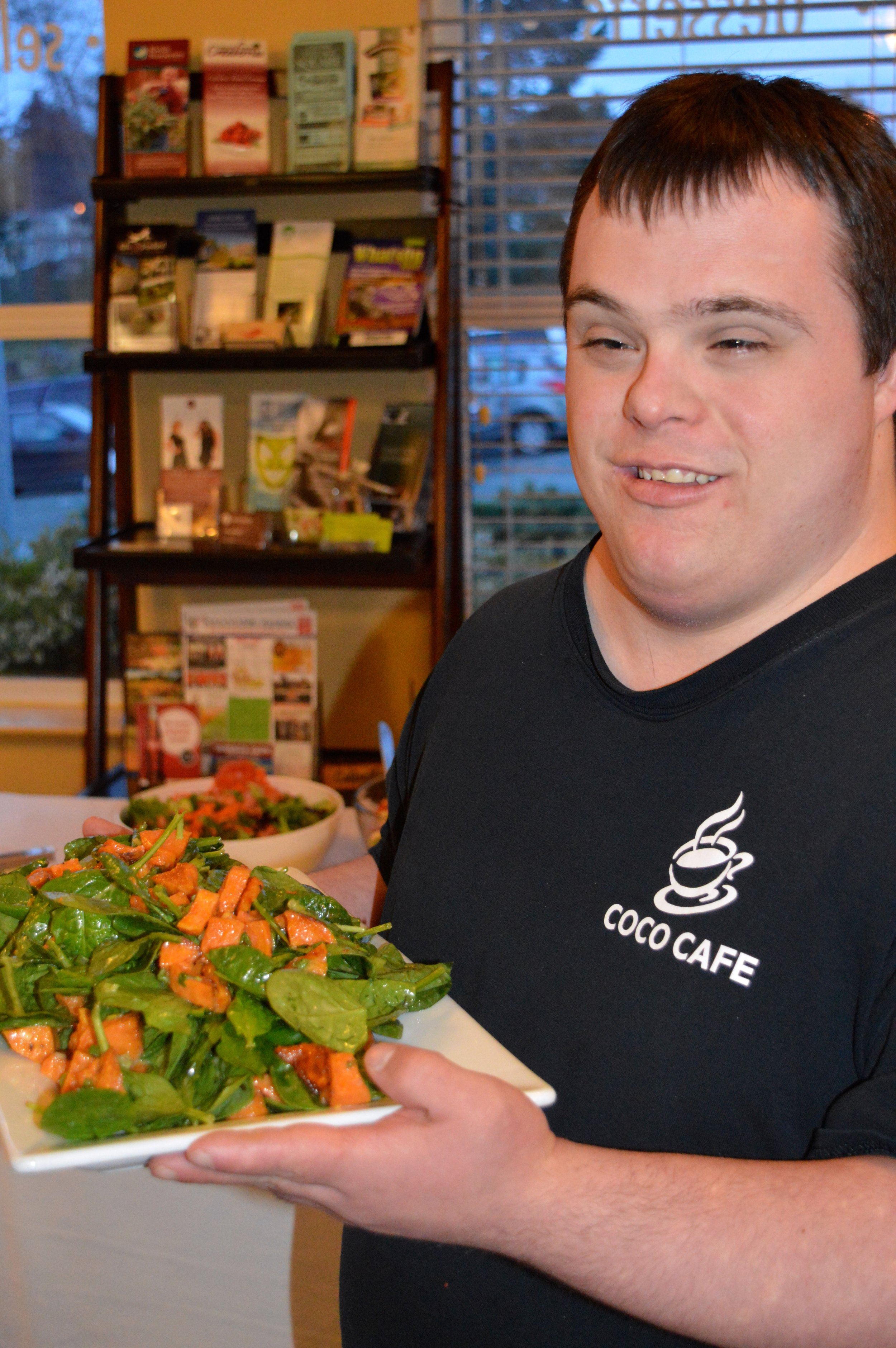 Mark serving our Roasted Yam & Spinach Salad