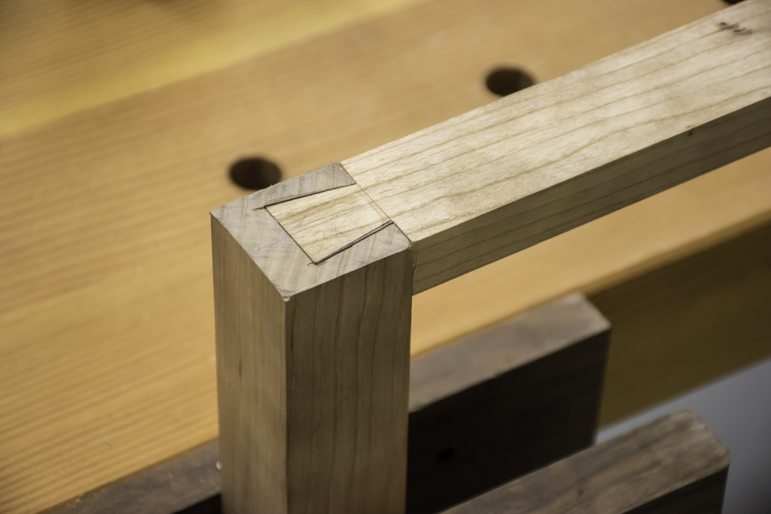 The dovetail is a strong mechanical joint to attach the upper stretchers to the legs.
